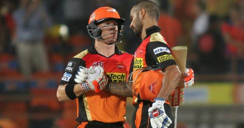 Dhawan and Warner celebrate a victory together.