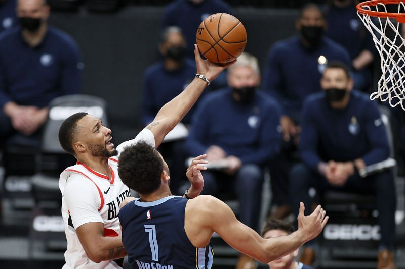 Norman Powell #24 shoots against Kyle Anderson #1
