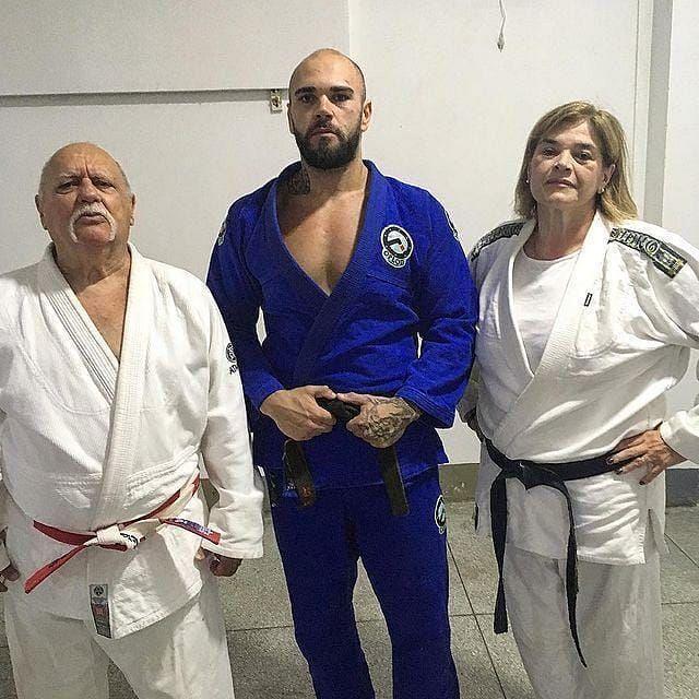 Giacomo Lemos stands between his Judo black belt parents