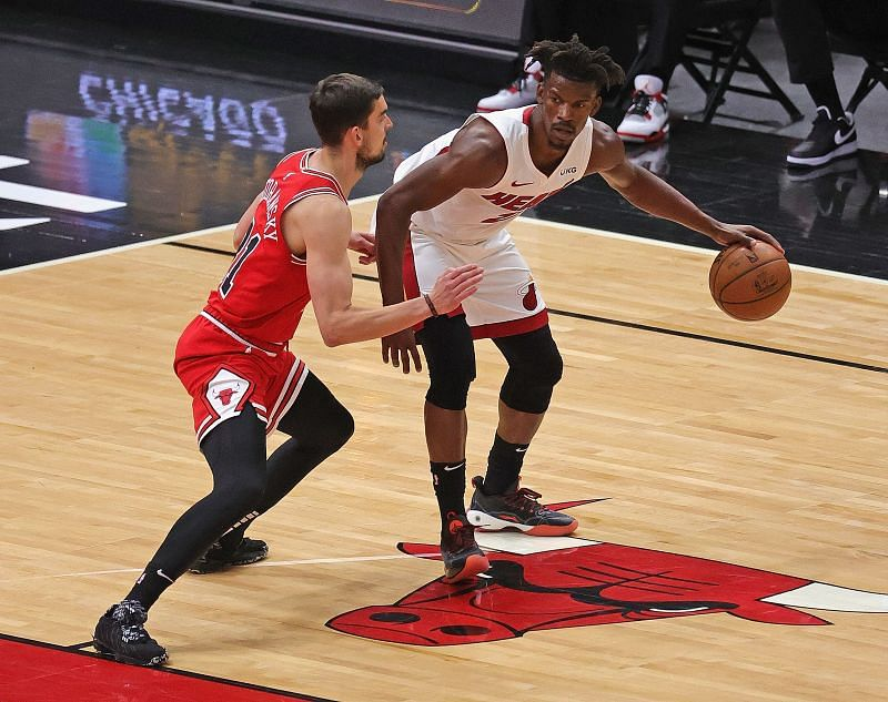 Jimmy Butler is guarded by Tomas Satoransky