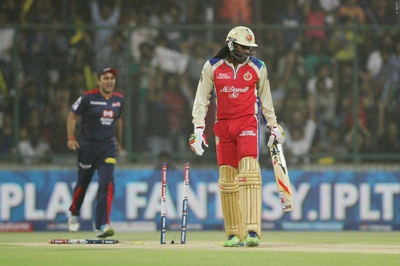 Chris Gayle of RCB is bowled by Irfan Pathan of DD. (Source: Sportzpics for BCCI/IPLT20)