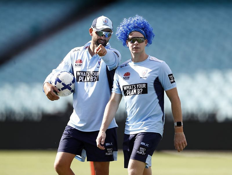Nathan Lyon (L) with Steve Smith.