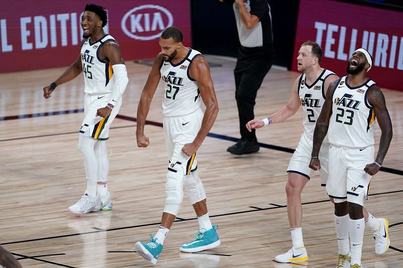 Rudy Gobert #27 celebrates a defensive stop with his teammates