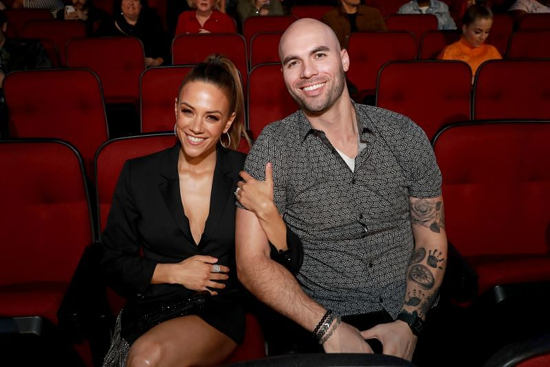Jana Kramer and Mike Caussin at the 2019 iHeartRadio Music Awards (via Getty Images)