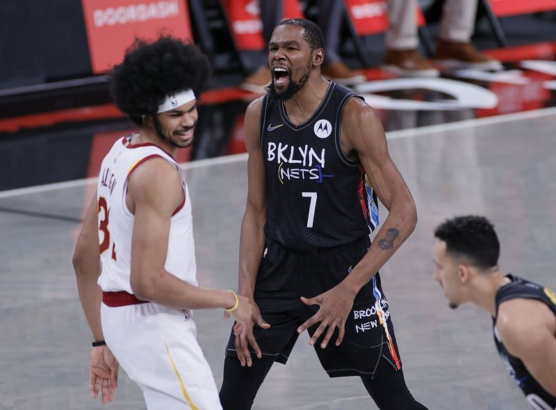 Kevin Durant #7 reacts after Jarrett Allen #31 beats him to the tip-off.