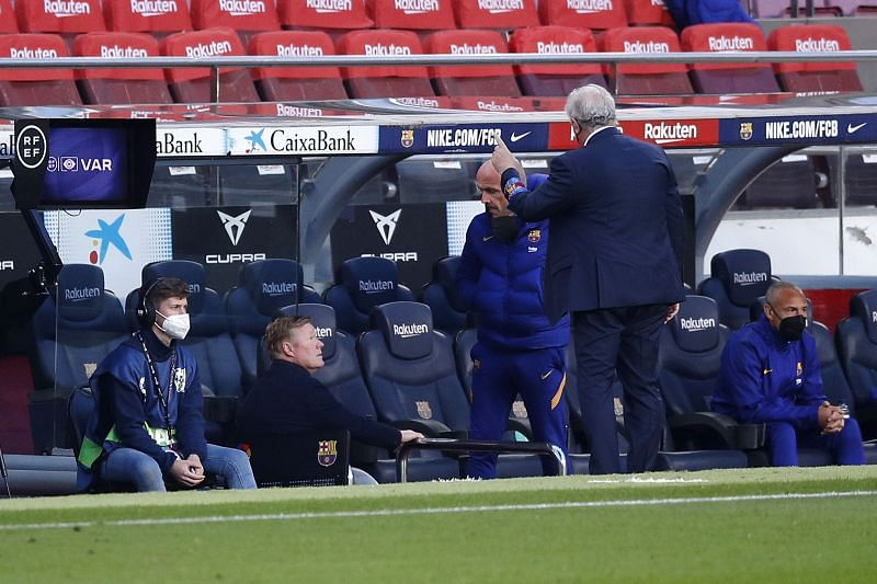 Ronald Koeman, Head coach of FC Barcelona leaves the pitch after being shown a red card