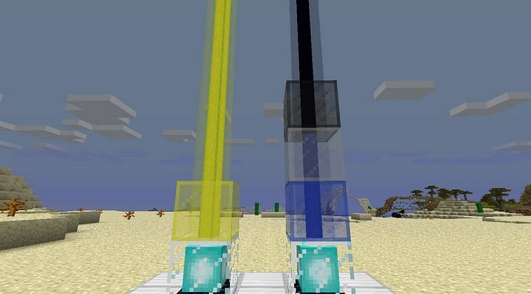 Examples of Beacons being manipulated by Stained Glass (Image via minecraftforum)