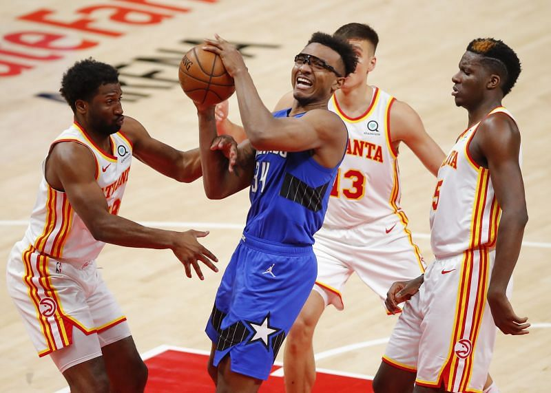 Wendell Carter Jr. #34 is fouled by Solomon Hill #18.