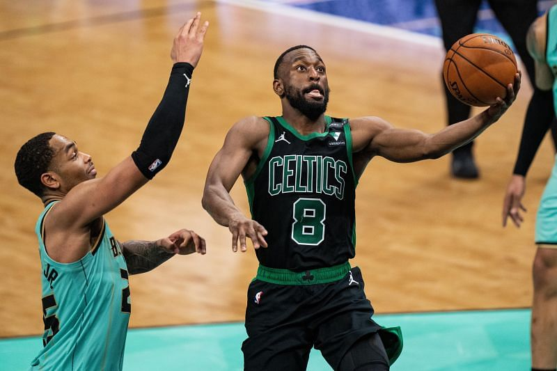 Kemba Walker #8 drives to the basket while being guarded by P.J. Washington #25.