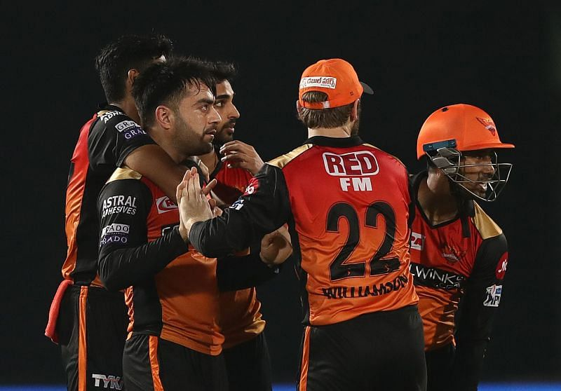 SRH players celebrating a fall of a wicket.