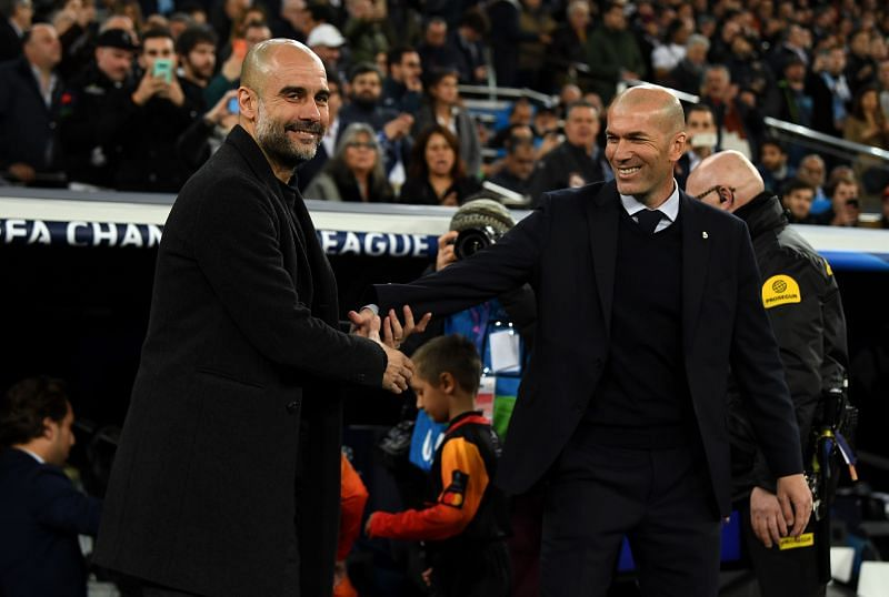 Pep Guardiola (left) and Zinedine Zidane (right) greet each other