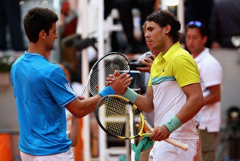 Novak Djokovic and Rafael Nadal embrace after their 2009 Madrid semifinal
