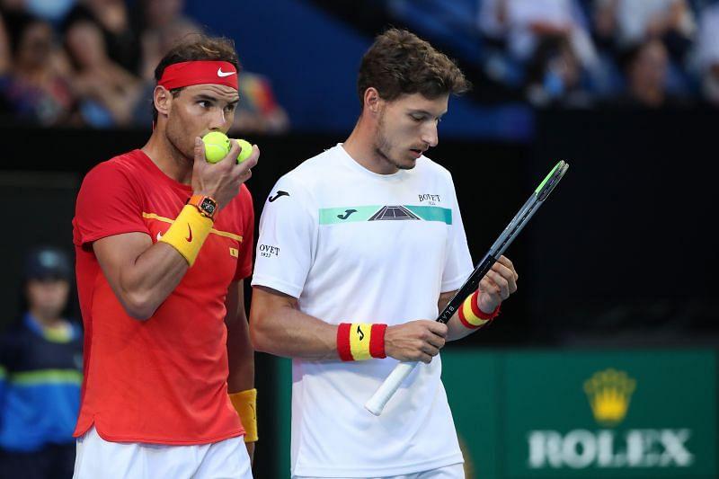 Rafael Nadal (L) and Pablo Carreno Busta