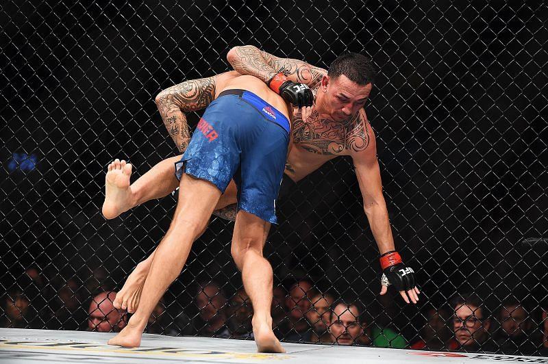Dustin Poirier taking down Max Holloway