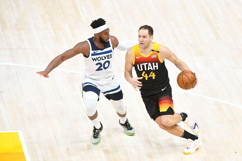 Bojan Bogdanovic #44 of the Utah Jazz drives against Josh Okogie #20 of the Minnesota Timberwolves.