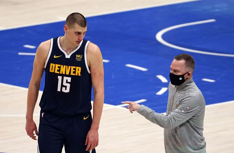 Mike Malone and Nikola Jokic #15 in the third quarter at American Airlines Center.