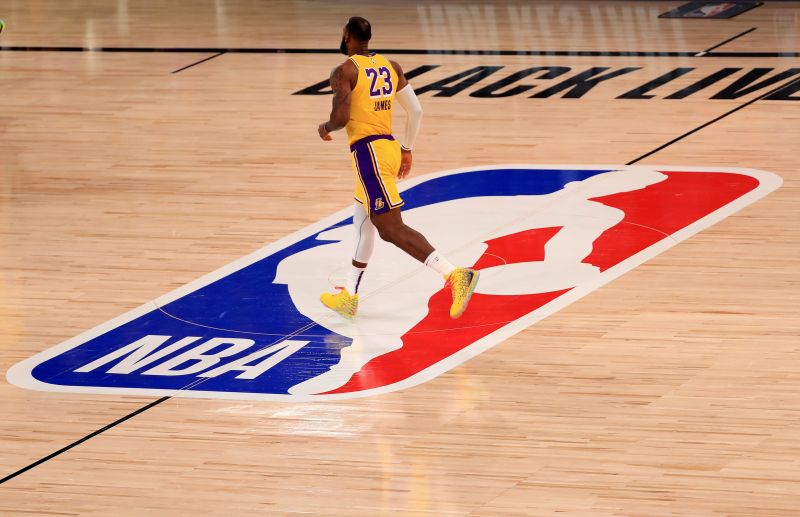LeBron James #23 of the Los Angeles Lakers runs past the NBA logo