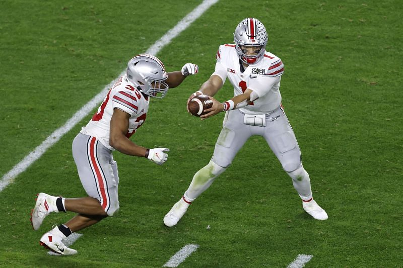 Ohio State quarterback Justin Fields hands off the football during the third quarter of the College Football Playoff National Championship against Alabama on Jan. 11, 2021.