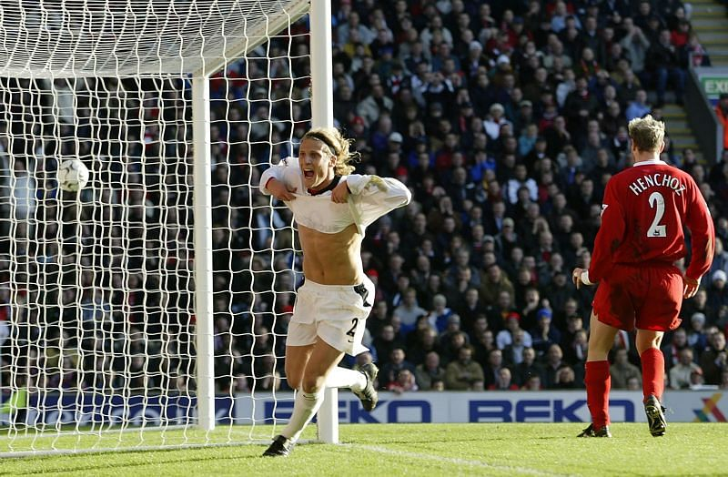 Diego Forlan of Manchester United celebrates scoring the first goal of the FA Cup match against Liverpool