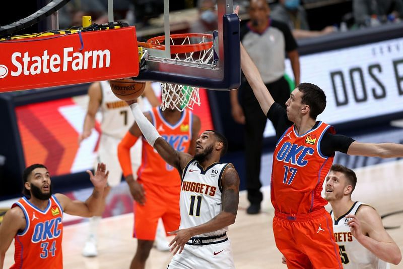 Monte Morris (#11) of the Denver Nugget in action