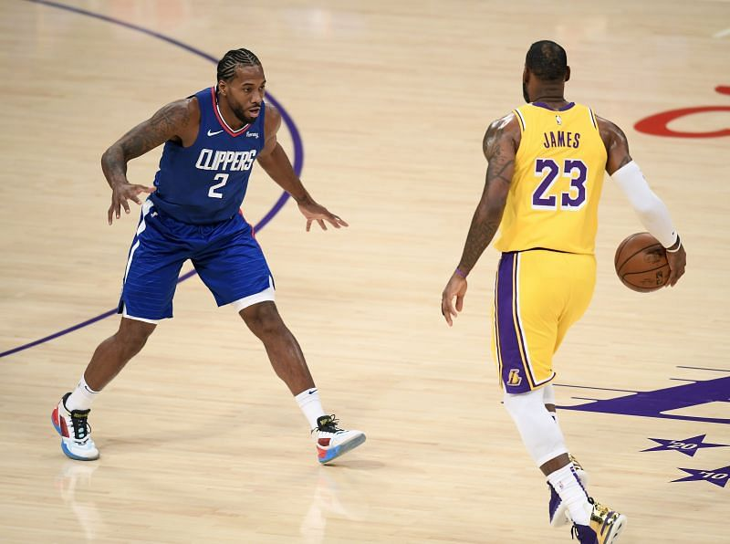 Kawhi Leonard (#2) guards LeBron James (#23).