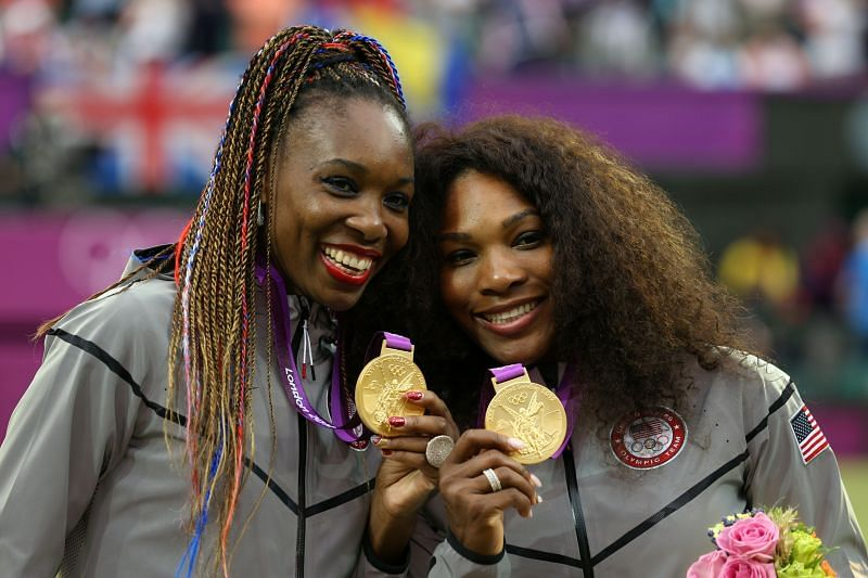 Venus and Serena Williams pose with their gold medals at the 2012 London Olympics