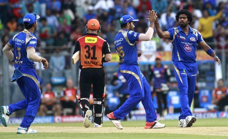 Lasith Malinga and Rohit Sharma celebrating the wicket of David Warner (Credits: prokerala.com)