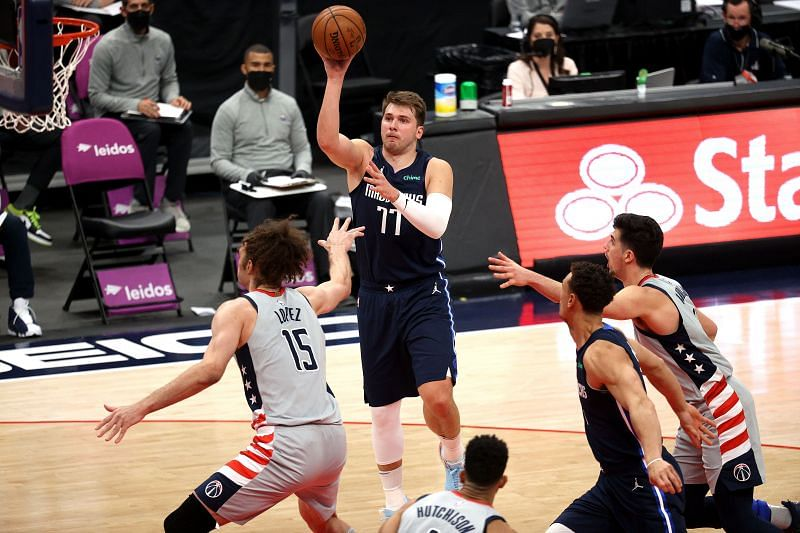 Luka Doncic #77 puts up a shot over Robin Lopez #15.