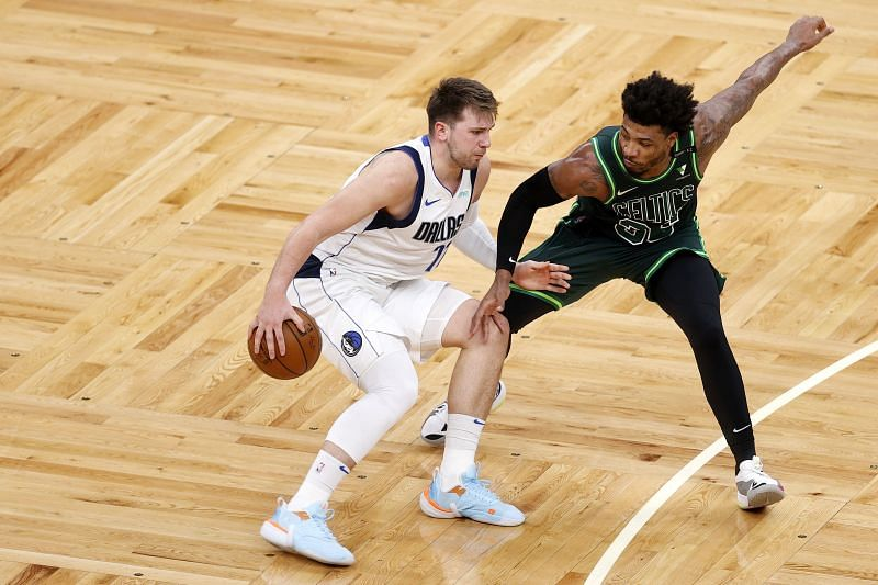 Marcus Smart (#36) defends Luka Doncic (#77).