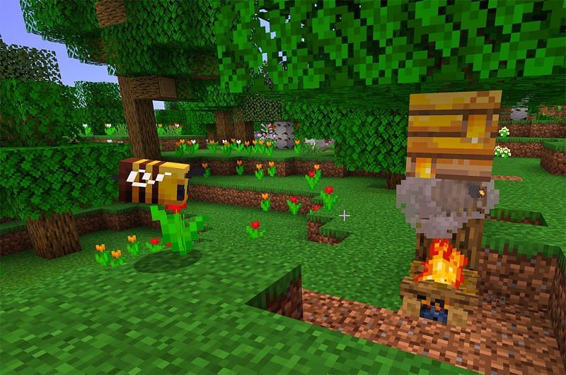 Harvesting honey in Minecraft (Image via 12tails)