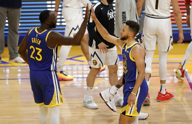 Stephen Curry #30 and Draymond Green #23 congratulate one another during a game