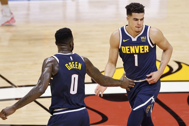 Michael Porter Jr. #1 and JaMychal Green #0 celebrate after a three-pointer.