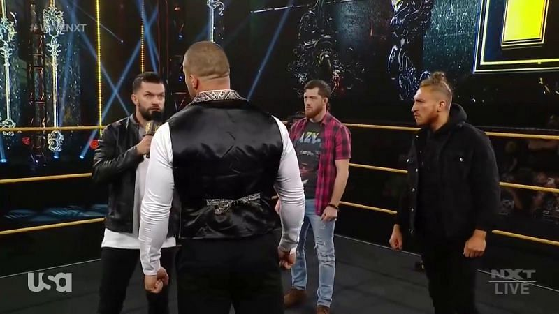Karrion Kross being confronted by Finn Balor, Kyle O