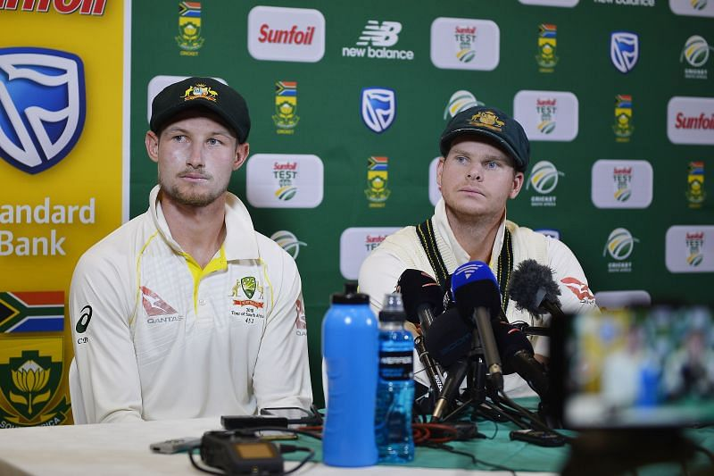 Cameron Bancroft (L) and Steve Smith (R) during the press conference at the end of Day 3 of the Cape Town Test