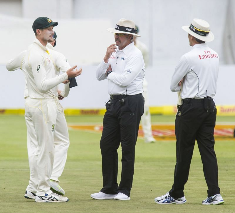 Cameron Bancroft being questioned by umpires Nigel Llong and Richard Illingworth after the cameras caught him in the act