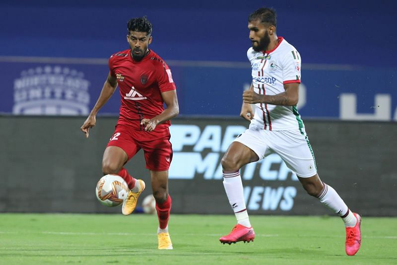 Ashutosh Mehta (left) in action for NorthEast United FC against ATK Mohun Bagan in the previous season of the ISL