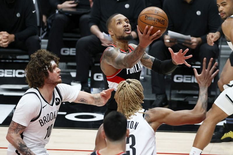 Damian Lillard #0 attempts a lay up against the Brooklyn Nets during the third quarter at Moda Center.