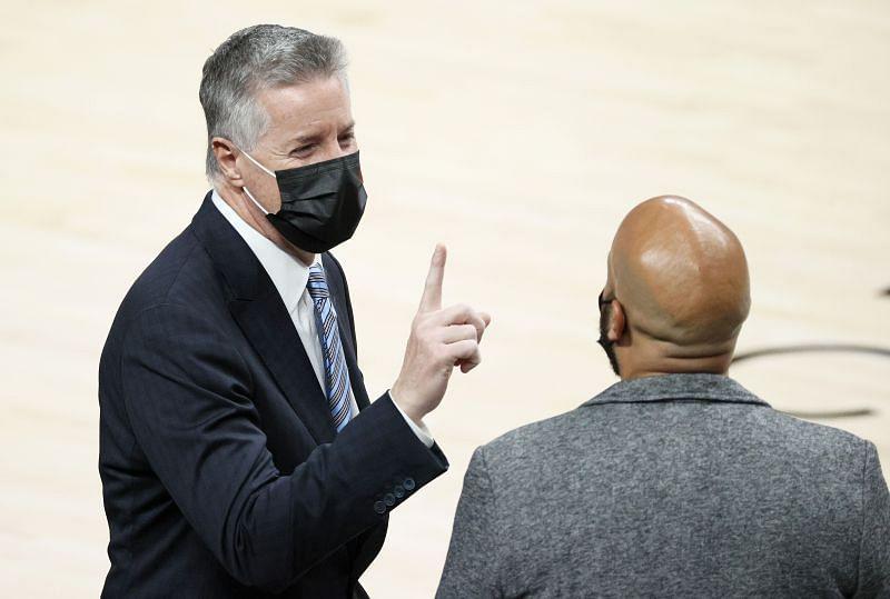 GM Neil Olshey of the Portland Trail Blazers speaks with GM Rafael Stone of the Houston Rockets.