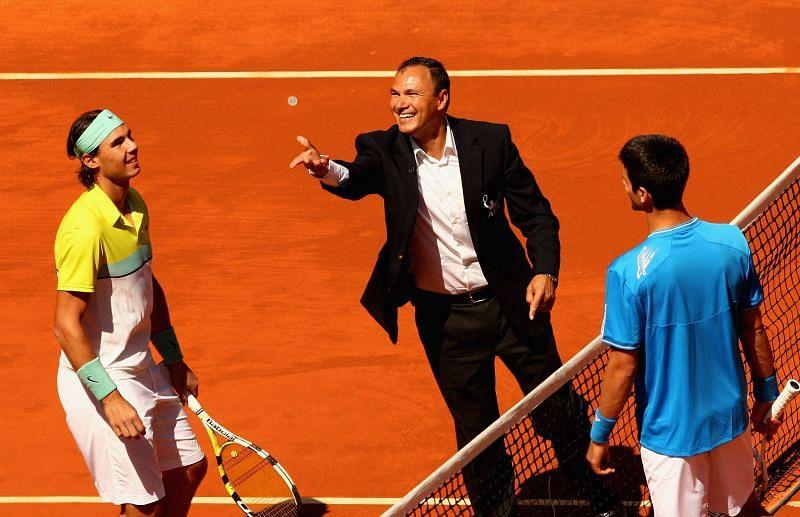 Rafael Nadal and Novak Djokovic (R) at the net before the match
