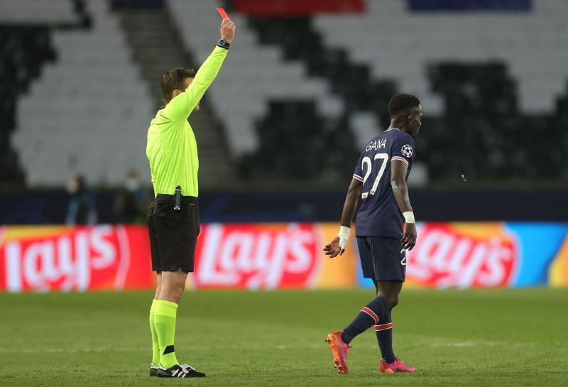 Idrissa Gueye is shown a red card by Referee Felix Brych after a reckless challenge on Gundogan