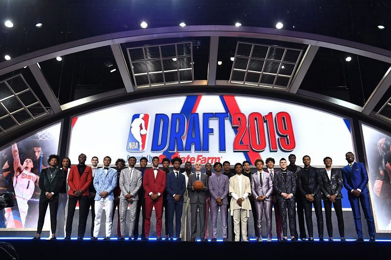 Draft prospects stand on stage with NBA Commissioner Adam Silver before the start of the 2019 NBA Draft.