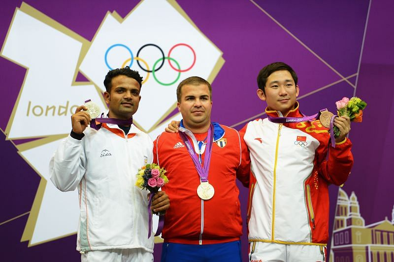 Vijay Kumar (left) on the podium with his silver medal at the 2012 London Olympics
