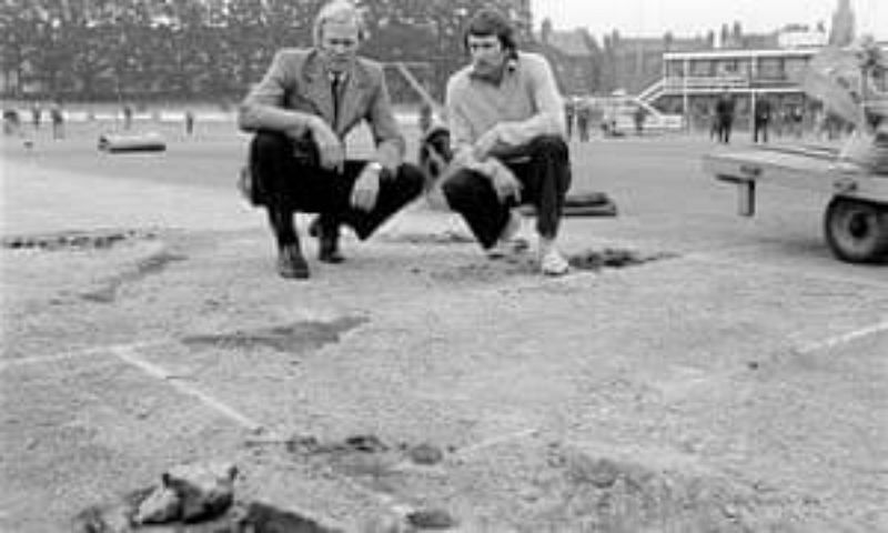 Ian Chappell and Tony Greig analyze the damage done to the Headingley pitch during the 1975 Ashes cricket match. Pic: @WSCupCricket/ Twitter