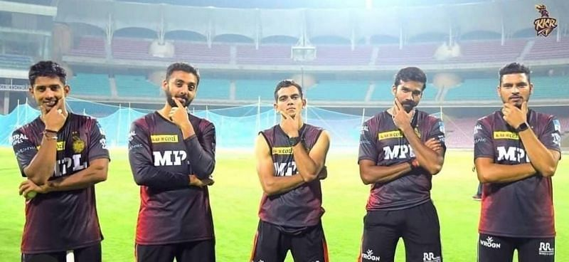 Varun Chakravarthy (second from left) and Sandeep Warrier (second from right) were the first to contract COVID-19 mid-season [Credits: KKR]