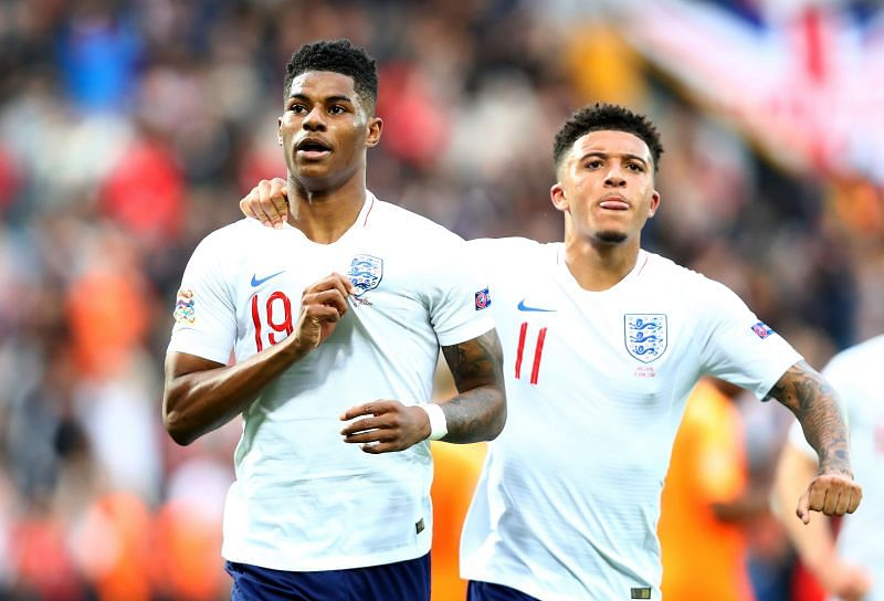 Marcus Rashford and Jadon Sancho celebrate a goal for England.