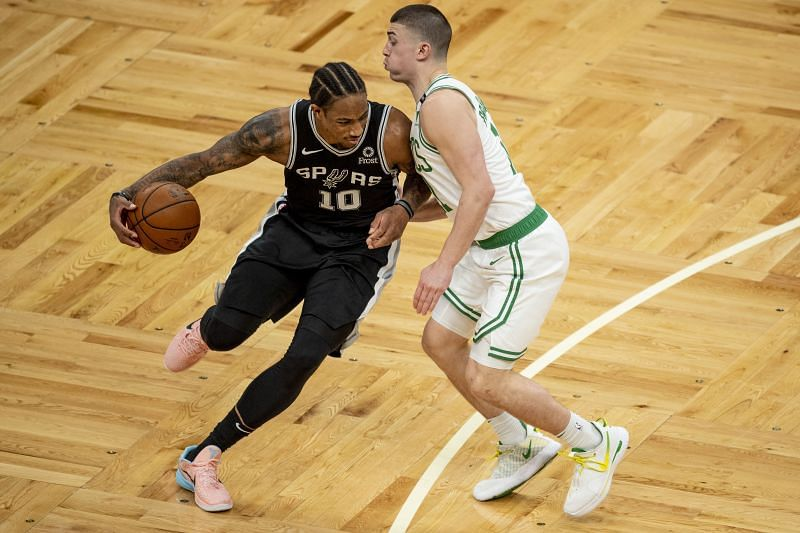 DeMar DeRozan #10 (left) of the San Antonio Spurs drives to the basket while guarded by Payton Pritchard #11 of the Boston Celtics
