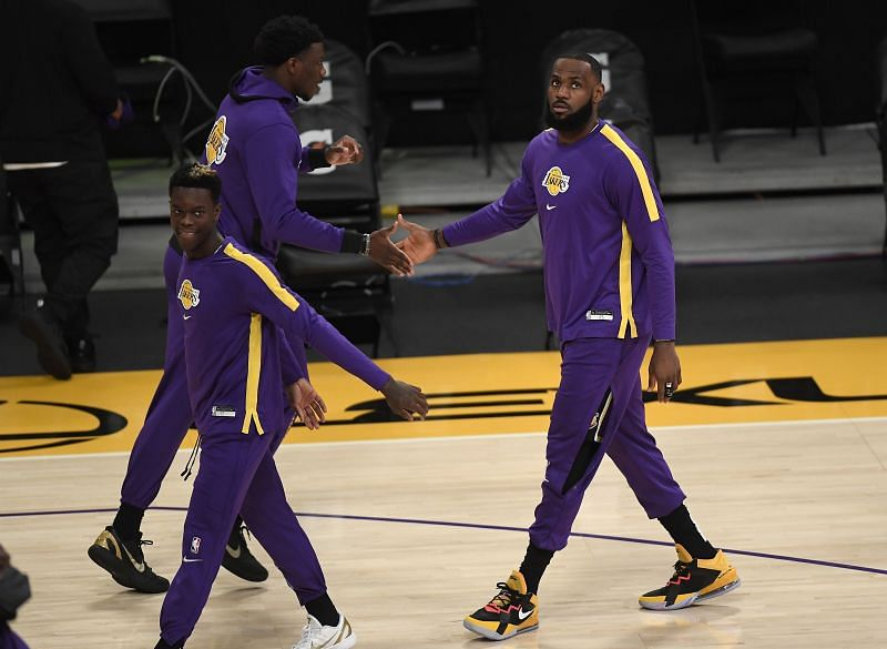 LeBron James (#23) is welcomed by Devontae Cacok (#12) during pre-game warm-ups.