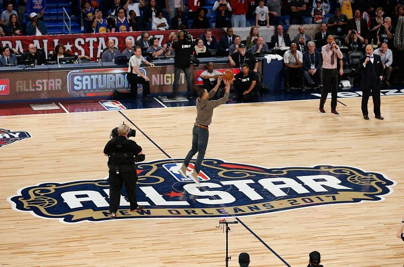 Stephen Curry #30 of the Golden State Warriors takes a half-court shot