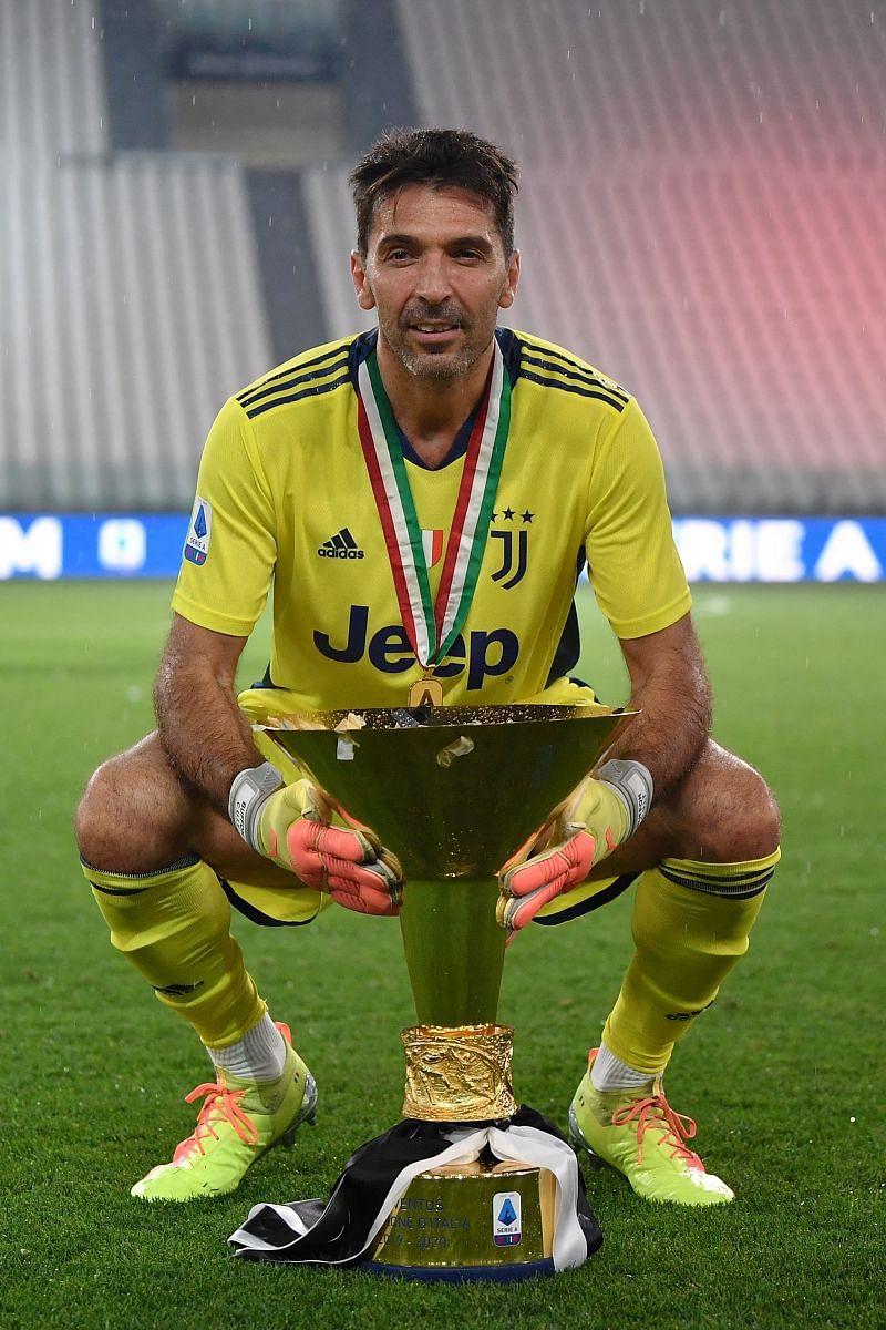Gianluigi Buffon with the 2019/20 Serie A trophy.