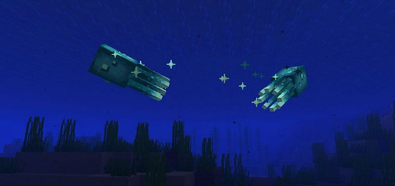 Two Glow Squid buddies enjoying the waters (Image via Minecraft)